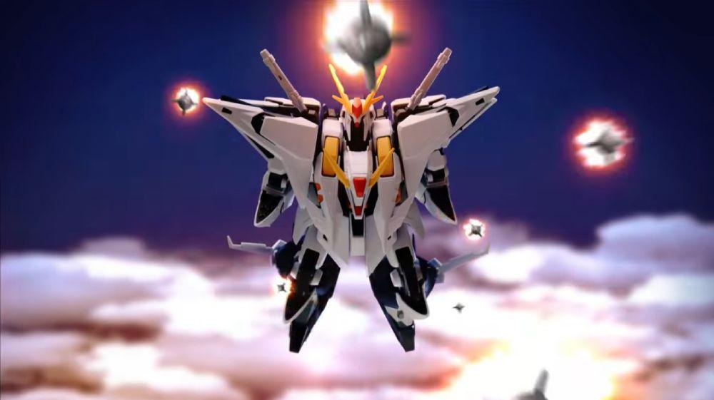 上空でファンネルミサイルを一斉発射するクスィーガンダム。