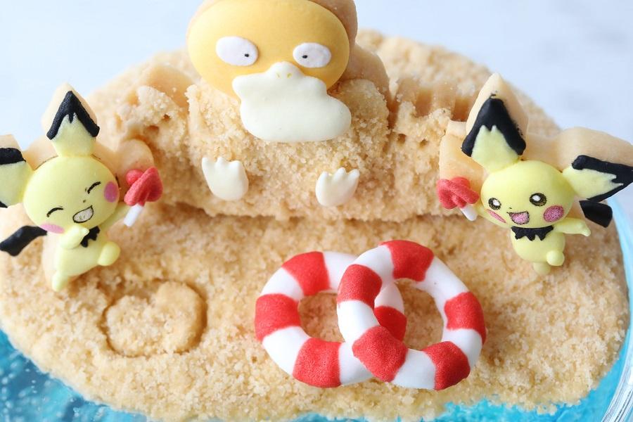 砂浜ではピチューとコダックが楽しそうに遊んでいます